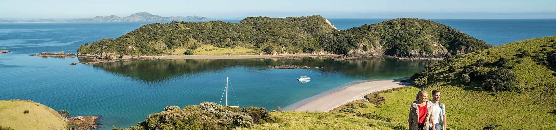 Couple enjoying walk overlooking scenery across Bay of Islands