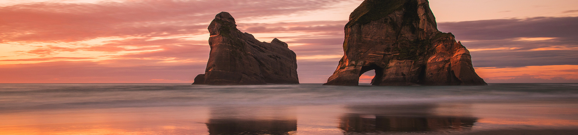 New Zealand beach landscape with red sky at dusk