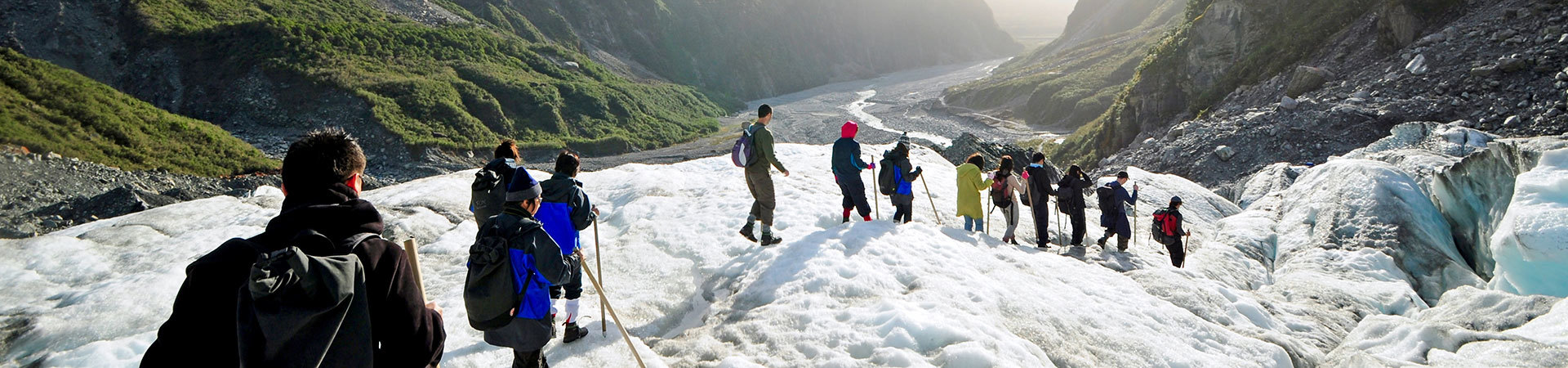 Group exploring the glaciers South Island New Zealand