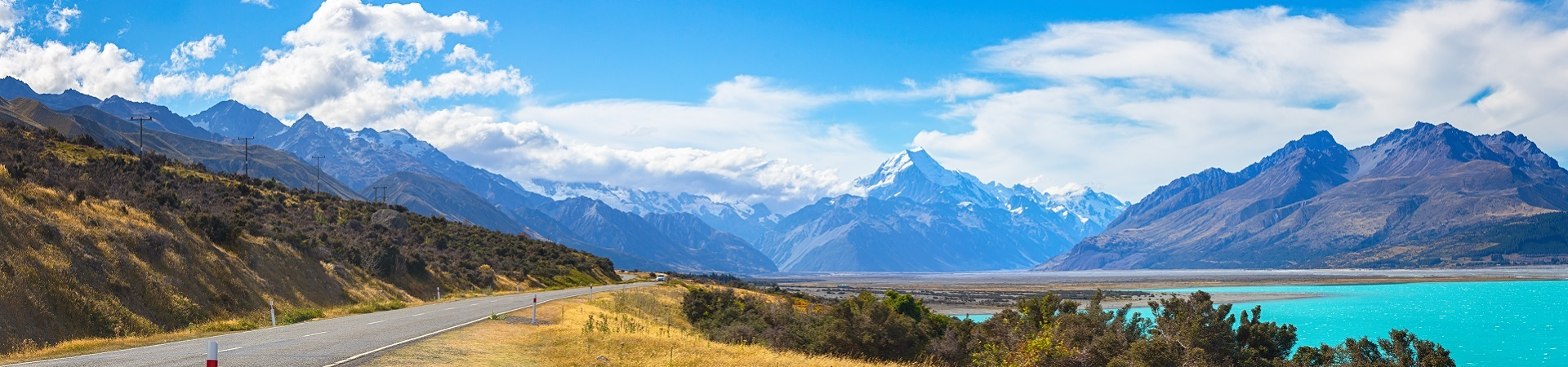 Road alongside a lake with Mt Cook in the distance
