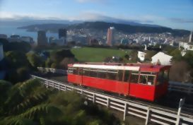 Red cabel car goes up hill in Wellington