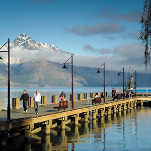 People walk along Queenstown warf