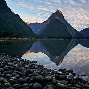 Evening reflections on the water at Milford Sound