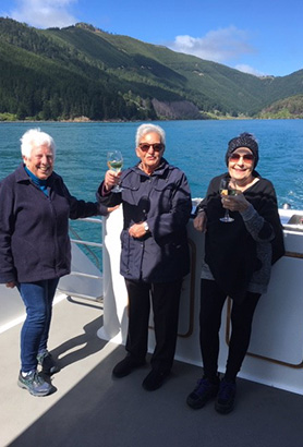 Tops of the South Island clients enjoying a wine on a cruise