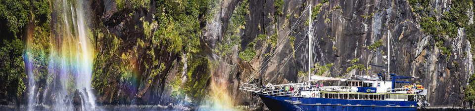 Real Journeys cruise boat explroing a waterfall