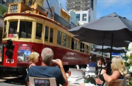 People watch the Christchurch Tram