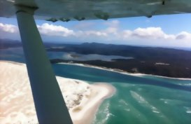 Flying over Northland in a plane