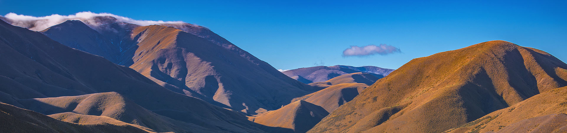 View of golden hills on the Lindis Pass, South Island New Zealand