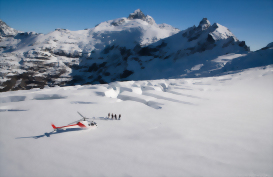 Visitors exploring the glaciers in the Southern Alps