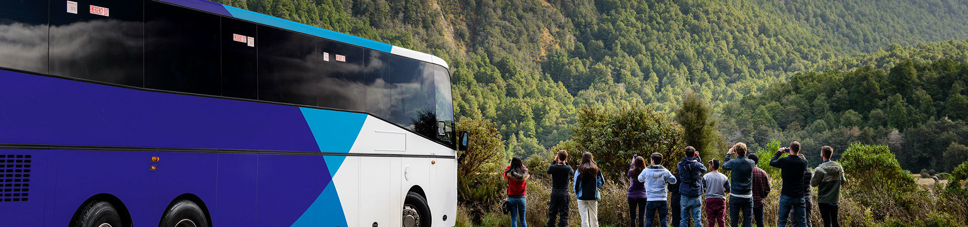 Exploring New Zealand by coach - visitors en-route to Milford Sound