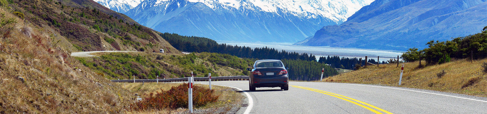 Car on road in South Island, New Zealand