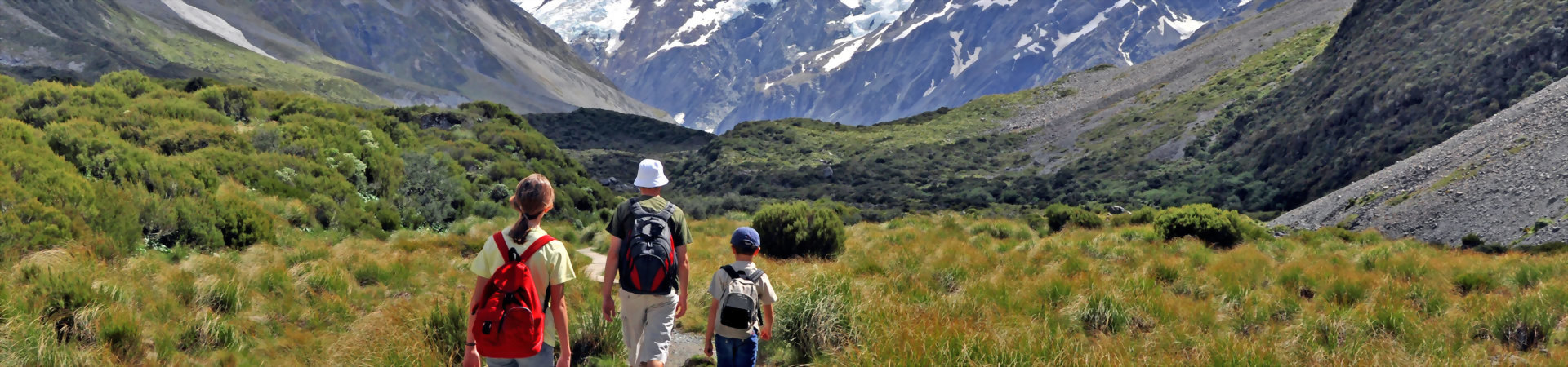 Family enjoying one of the hiking trails in New Zealand mountains
